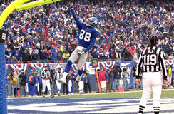 Ike Hilliard. Wide Receiver Ike Hillard of the New York Giants catches a pass from New York Giants Quarterback Kerry Collins Stock Image
