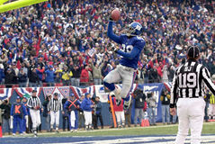 Ike Hilliard. Wide Receiver Ike Hillard of the New York Giants catches a pass from New York Giants Quarterback Kerry Collins Stock Photography