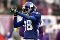 Ike Hilliard. Wide Receiver Ike Hillard of the New York Giants catches a pass from New York Giants Quarterback Kerry Collins at the NFC Championship game to Stock Photo
