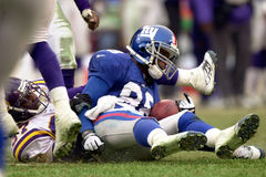 Ike Hilliard. Wide Receiver Ike Hillard of the New York Giants catches a   pass from New York Giants Quarterback Kerry Collins at the NFC Championship game.The Royalty Free Stock Photo
