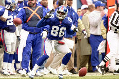 Ike Hilliard. Wide Receiver Ike Hillard of the New York Giants catches a pass from New York Giants Quarterback Kerry Collins at the NFC Championship game.The New Stock Photo