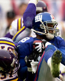 Ike Hilliard. Wide Receiver Ike Hillard of the New York Giants catches a   pass from New York Giants Quarterback Kerry Collins at the NFC Championship game.The Stock Photo