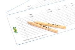 IKEA blyertspenna och shoppinglista royaltyfria foton