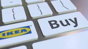 IKEA company logo and Buy text on the keys of the computer keyboard, editorial conceptual 3D rendering. Computer keyboard with company logo and text on the keys stock illustration