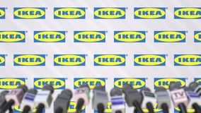 IKEA company press conference, press wall with logo and mics, conceptual editorial 3D rendering. Company press conference, conceptual editorial 3D stock illustration