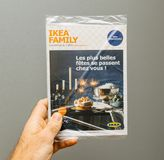Ikea Family advertising newsletter in male hand Royalty Free Stock Photo