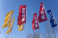 IKEA flags. Under the winter's blue sky Stock Image