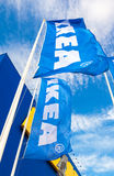 IKEA flags waving on wind against a blue sky near the IKEA Samar Royalty Free Stock Images