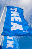 IKEA flags waving on wind against a blue sky near the IKEA Samar Stock Image