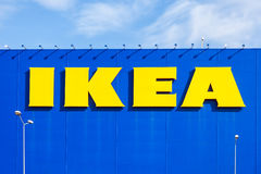 IKEA logo against a blue sky. Ikea is the world`s largest furnit Stock Photo