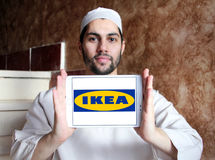 Ikea logo. Logo of the international chain of furniture stores ikea on samsung tablet holded by arab muslim man Stock Photo