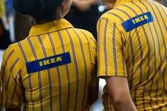 IKEA opening second store in Romania. Bucharest, Romania - June 24, 2019: IKEA staff dressed in uniforms are waiting the first buyers in the opening day of the royalty free stock images