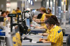 IKEA opening second store in Romania. Bucharest, Romania - June 24, 2019: IKEA working staff at the cash registers are seen in the opening day of the IKEA royalty free stock photos