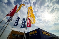 IKEA opening second store in Romania. Bucharest, Romania - June 24, 2019: Ikea flags are seen near the IKEA building in the opening day of the IKEA Pallady store stock image