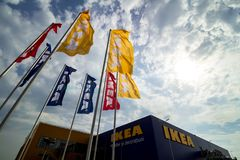 IKEA opening second store in Romania. Bucharest, Romania - June 24, 2019: Ikea flags are seen near the IKEA building in the opening day of the IKEA Pallady store stock photos