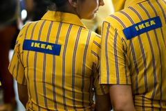IKEA opening second store in Romania. Bucharest, Romania - June 24, 2019: IKEA staff dressed in uniforms are waiting the first buyers in the opening day of the royalty free stock photo