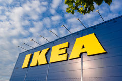 IKEA sign against blue sky. IKEA building with logo against blue sky Royalty Free Stock Images