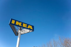 IKEA sign. The huge IKEA logo in the A huge billboard triangular column under the winter's blue sky Royalty Free Stock Images