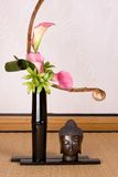 Ikebana and buddha Royalty Free Stock Photos