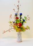 Ikebana. Flower arrangement. In the house Royalty Free Stock Photo