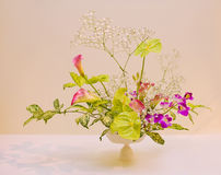 Ikebana. Flower arrangement. Kala and orchid flowers in the vase Stock Photography