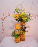 Ikebana. Flower arrangement. Mapple leaves Stock Images