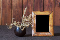 Ikebana and old photo frame Stock Photo