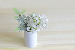 Ikebana With Sprigs of Apple blossoms and blue spruce in a vase Royalty Free Stock Photo