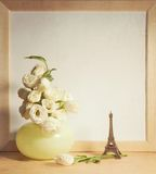 Ikebana and vintage photo-frame on table. Ikebana and vintage white photo-frame on table royalty free stock image