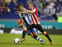 Iker Muniain of Athletic Bilbao. Iker Muniain(R) of Bilbao vies with Stuani(L) of Espanyol during a Spanish League match at the Estadi Cornella on September 23 Royalty Free Stock Photography