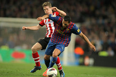 Iker Muniain(L) vies with Adriano(R) of Barcelona. Iker Muniain(L) of Athletic Bilbao vies with Adriano Correia(R) of Barcelona during the Spanish league match Stock Image