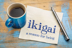 Ikigai - a reason for being. Ikigai - Japanese concept - a reason for being or a reason to wake up - handwriting on a napkin with a cup of espresso coffee royalty free stock photo