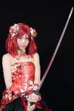 Iklädd cosplay dräkt för ung asiatisk flicka Royaltyfri Foto