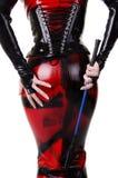 Iklädd dominatrixkläder för kvinna Fotografering för Bildbyråer