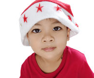 Iklädd isolerad Santa Claus för asiatisk pojke dräkt Arkivfoton