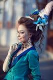 Iklädd rokokostil för härlig caucasian flicka Fotografering för Bildbyråer