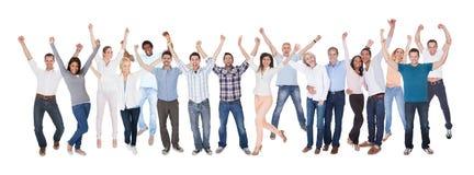 Iklätt tillfälligt för lycklig grupp människor arkivbild