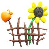 Ikona ogrodzenie, miotacz i słonecznik plasteliny, Zdjęcie Royalty Free