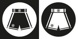 Ikone der Verpackenkurzen hosen Schattenbildverpackenkurze hosen auf einem Schwarzweiss-Hintergrund Ein Ski Auch im corel abgehob Stockbilder