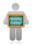 Ikone, die eine Holzdarstellung der gesunden Ernährung hält Stockfotografie