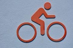 Ikone einer Person reinigt ein Fahrrad Lizenzfreie Stockfotos