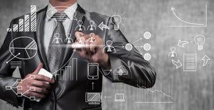 Ikone und Gegenstand des Geschäftsmannabgehobenen betrages für Unternehmensplan Stockfoto