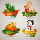 Ikonen der frohen Weihnachten in den verschiedenen Sprachen Stockfotografie