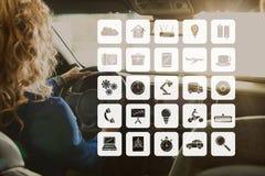 Ikonen gegen Frau im Auto Stockbilder