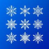 ikony ilustracyjny odosobniony ustalony płatka śniegu wektoru biel biali kolorów płatki śniegu odizolowywający na błękitnym tle Z obraz royalty free