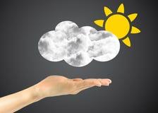 Ikony słońce z chmurami w mężczyzna ręce Zdjęcie Royalty Free