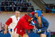 Ikram Aliskerov (r) combat Jeon Yong juin (b) Photos libres de droits