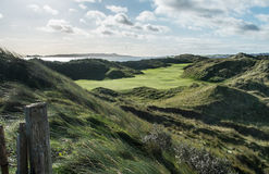 Links golf course with large sand dunes and wind blown rough Royalty Free Stock Images