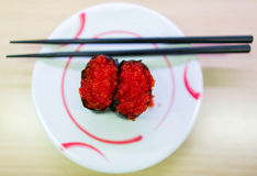 Ikura Sushi with red caviar on the ceramic plate Royalty Free Stock Photo