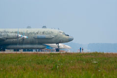 Il-20 plane at the airbase. KUBINKA, RUSSIA - AUGUST 14: an old Il-20 surveillance plane stands on the far parking during the celebration of 100th anniversary of Royalty Free Stock Photography